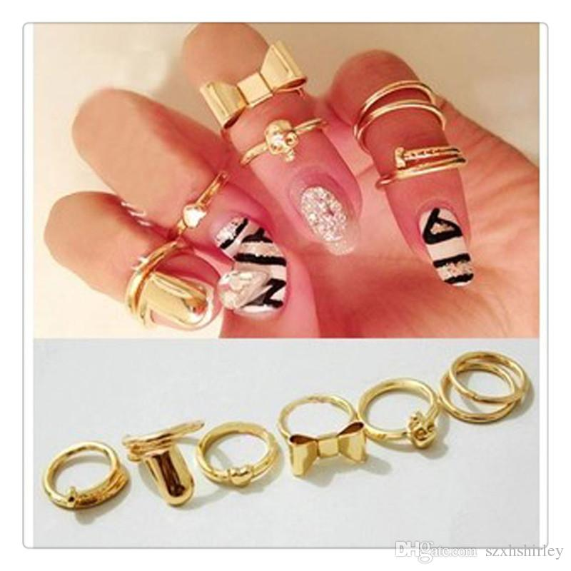 Comercio al por mayor de Moda Anillos de Dedo 7 Unids Conjunto Vogue Gold Skull Bowknot Corazón Diseño Simple Nail Band Mid Finger Ring Set Nail Art Ring Free DHL