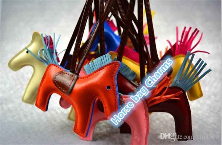 Nuevo es de moda lindo bolso de las mujeres colgante de gama alta hecho a mano bolso de la PU llaveros borla rodeo bolsa de caballo bolso del encanto accesorios 2332
