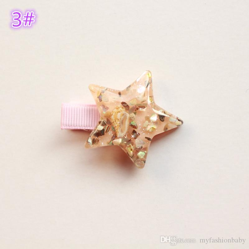 2017 Clip de Verano Estilo estrellas de mar brillantes del pelo de Corea del pelo de los bebés Accesorios Mar rosado de la estrella de las horquillas de horquilla Estrellas princesa linda