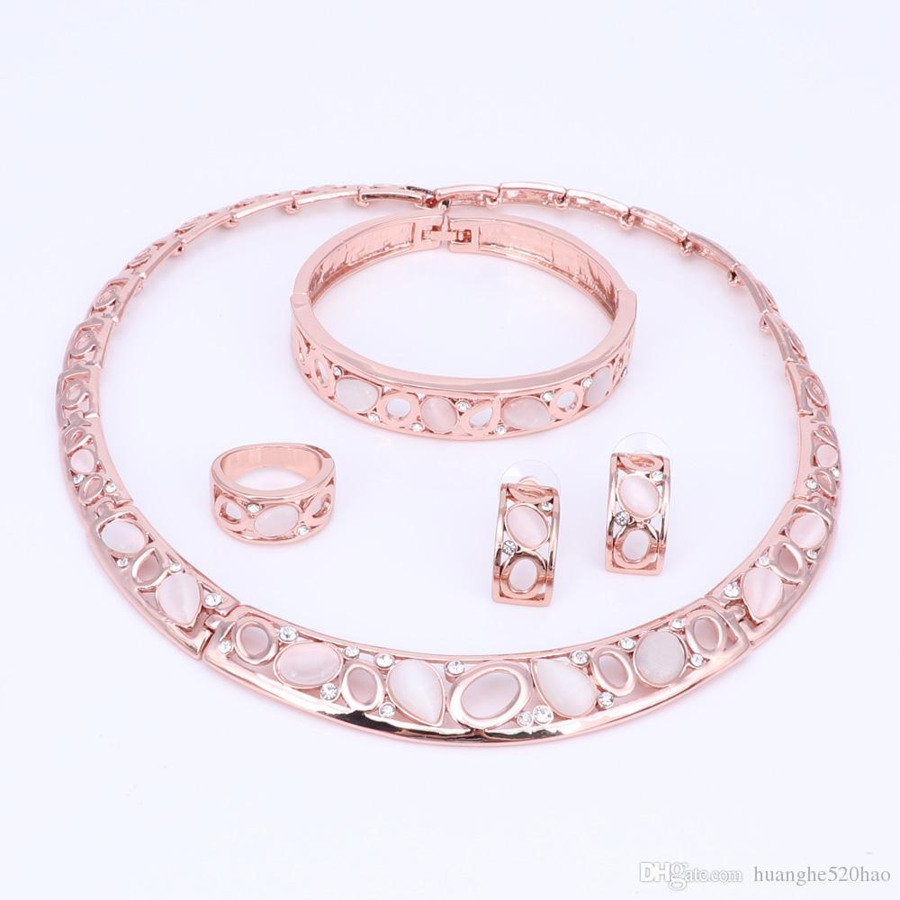 Set di gioielli Fashion Party Set Cat Pink Eye opale con strass goccia orecchini delle collane Bangle Ring donne / ragazze