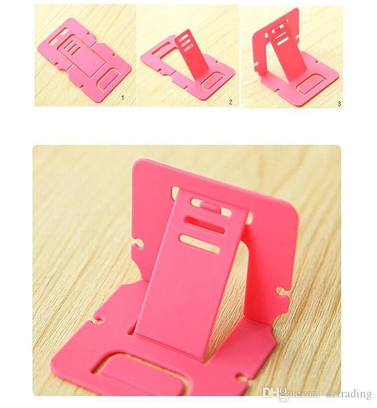 Di buona qualità Il telefono piegante portatile di plastica della carta monta il supporto del supporto della compressa del telefono cellulare il PC della Tabella del telefono