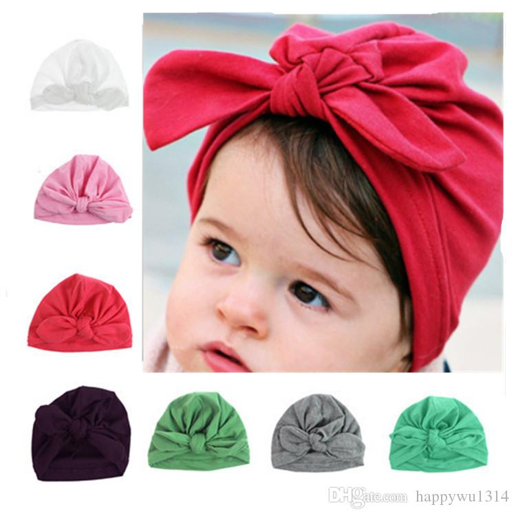 2019 2017 Infant Rabbit Ears Hats Baby Girls Bohemia Twisted Knot Soft  Hedging Cotton Hat Newborn Autumn Winter Warm Cotton Caps Hair Accessories  From ... afe9ef55501