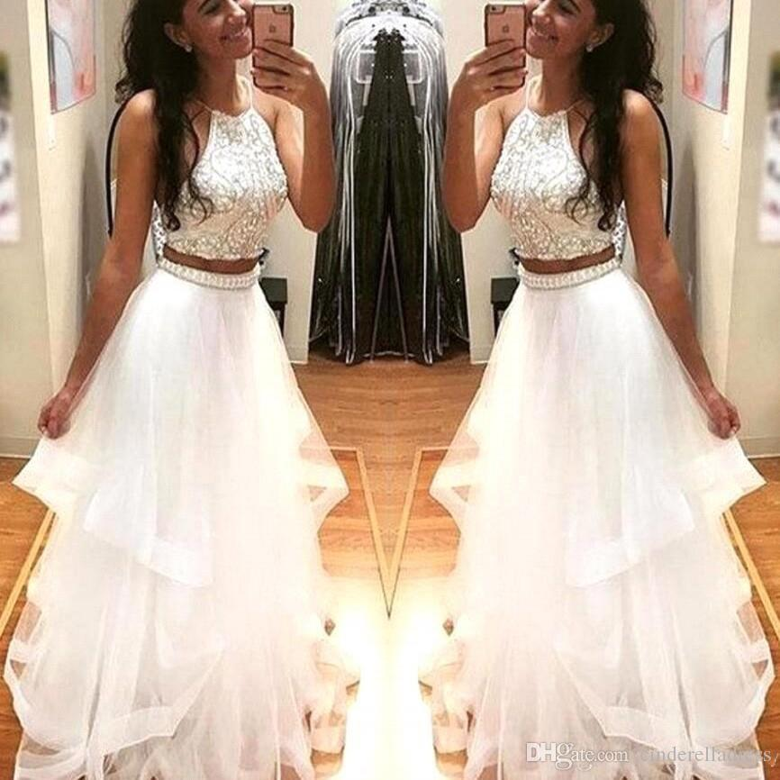 5d9574b1abbfb 2018 Sexy White Two Pieces Ball Gown Prom Dresses Halter Neck Crystal Top  Tiered Skirts Ruffles Long Evening Gowns With Beaded Peplum BA5203