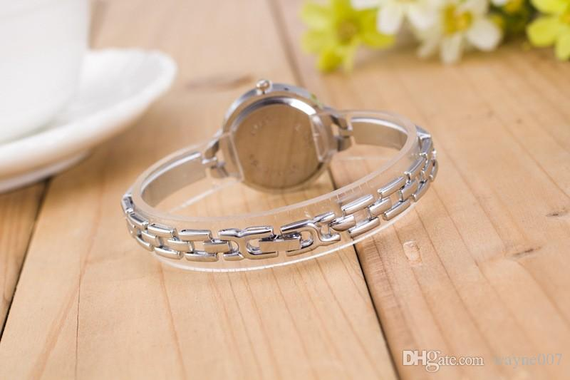 2017 estilo delgado para mujer reloj de pulsera de metal de aleación de pegamento plástico vestido de moda reloj de ocio cuarzo damas barato al por mayor JW