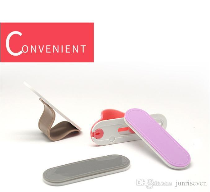 Support de téléphone portable créatif anneau support multifonctionnel retour coller support fixe Smart Finger Grip Autoportant Autocollant Support de téléphone