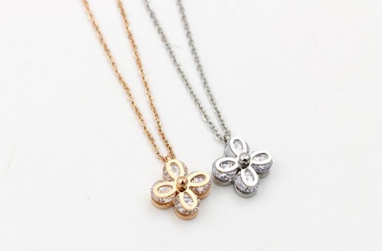 New four-diamond four-leaf flower short necklace female Korean fashion trend wild titanium plated rose gold clavicle chain