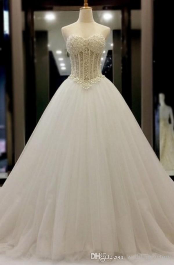 Fantastisk en linje bröllopsklänning lyxpärlor pärlor topp ärmlös tulle kjol bröllopsklänningar högkvalitativa brudklänningar skräddarsydda
