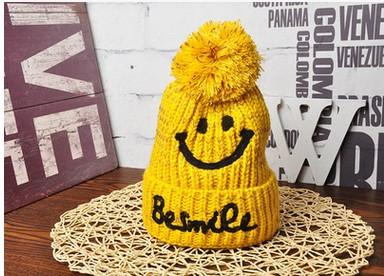 2017 new hat. Children's hat. Winter hat. Smiling face. Wool ball. Casual fashion hat. Boy. Girl. Baby. Knitted cotton. Keep warm. Add wool.