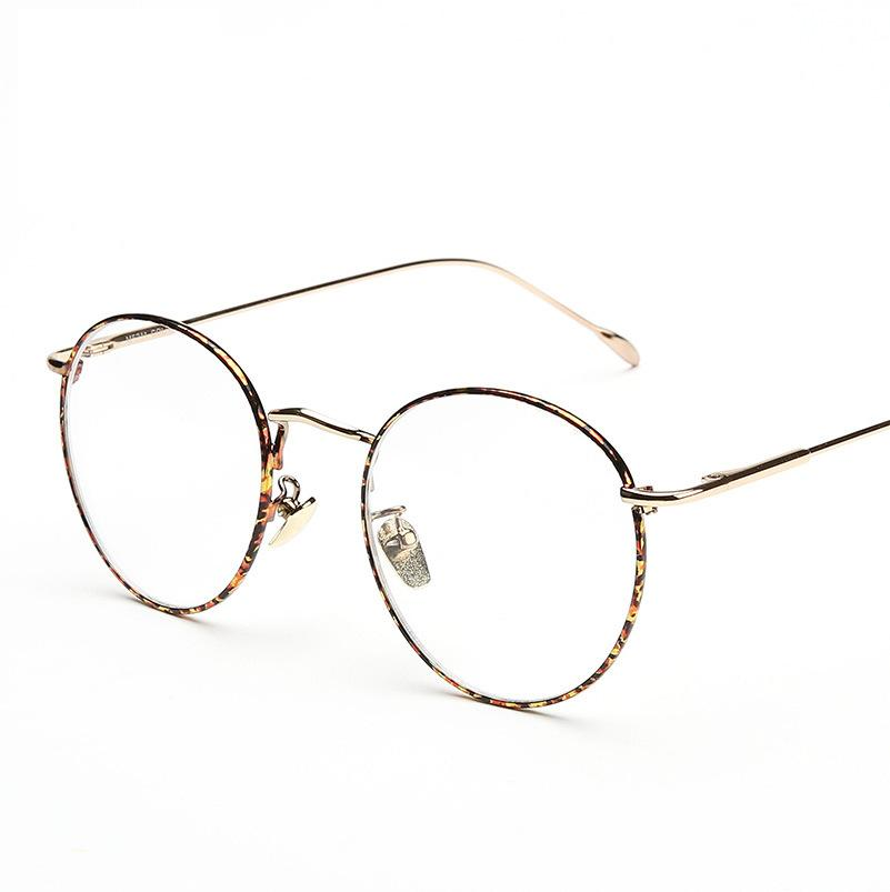 c9f5c58cb34 2019 Wholesale New Designer Woman Glasses Optical Frames Metal Round Glasses  Frame Men Clear Lens Eyeware Black Gold Pattern Eye Glass From Huteng