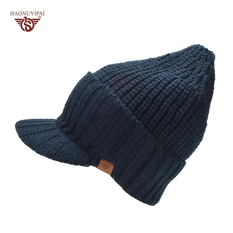 e9a55f71f5d Men  S Autumn And Winter Warm Wool Knitted Hats With Visor Brand Hnyp Brim  Outside Ear Protection Knit Skiing Beanies Cap 2017 Crochet Beanie Pattern  Beard ...