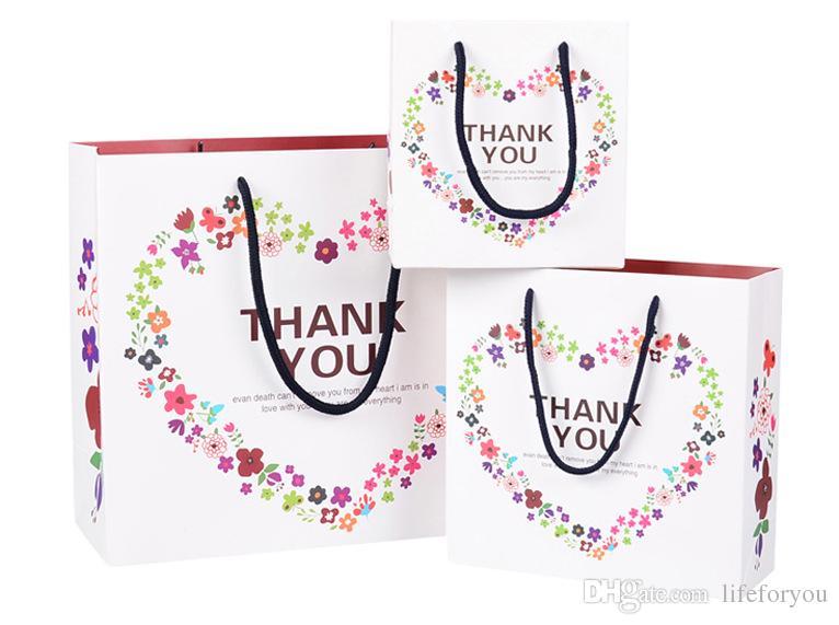 أكياس الورق هدية أكياس هدايا الزفاف الإحسان أكياس هدايا الزفاف للضيوف حزب هدية حقيبة حزب الإحسان حقيبة