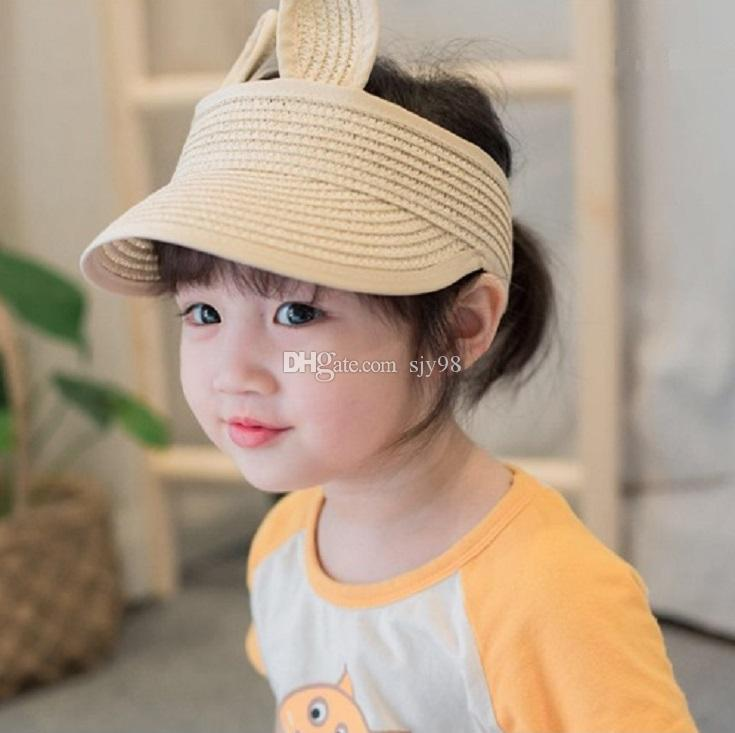 f2478c3c04c 2019 2017 New Lovely Baby Straw Hats For Girls Boys Character Rabbit Ears  Decoration Sun Hat Kids Solid Beach Caps Children Summer Cap From Sjy98