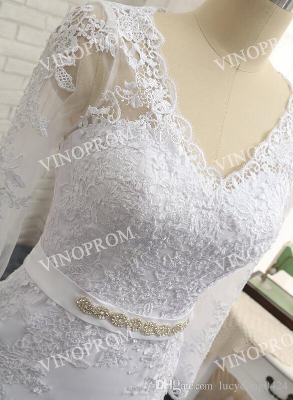 Elegante apliques blancos Vestidos de sirena Vestido de noche con cuello en V espalda hueca de manga larga Sweep Train Prom Vestidos