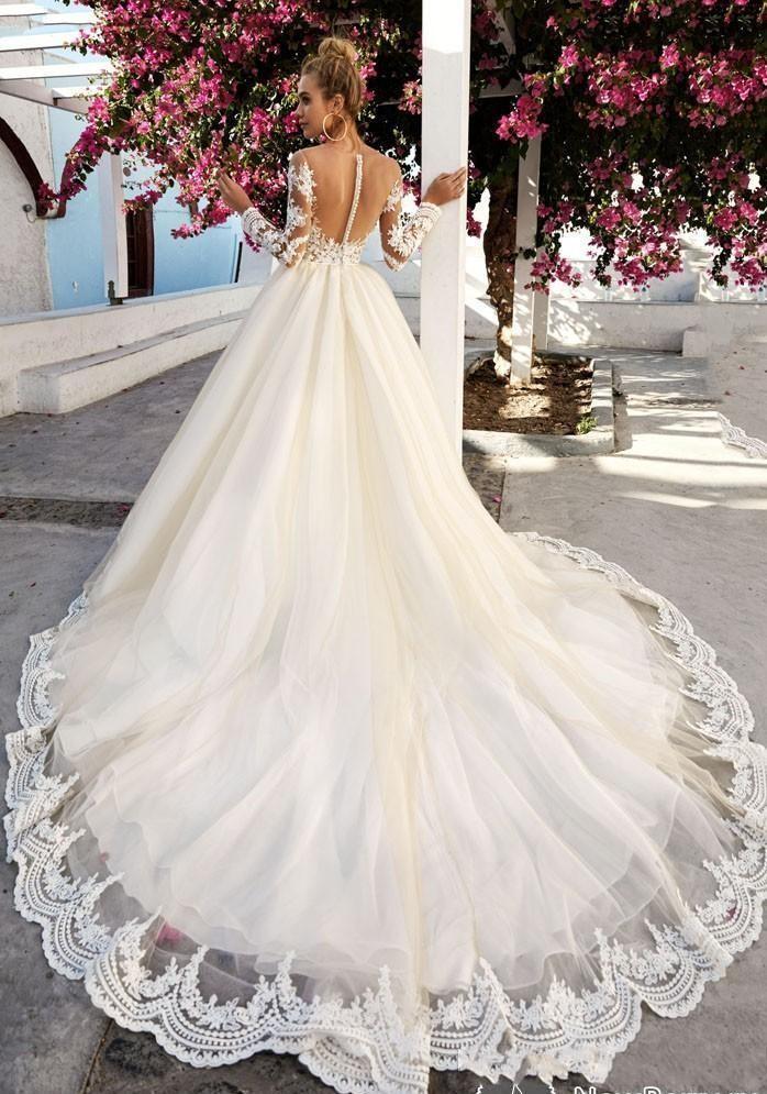 2019 dentelle vintage plus taille à manches longues dentelle dentelle robes de mariée col bateau beach corsice appliques robes de mariée arabe Dubai sur mesure