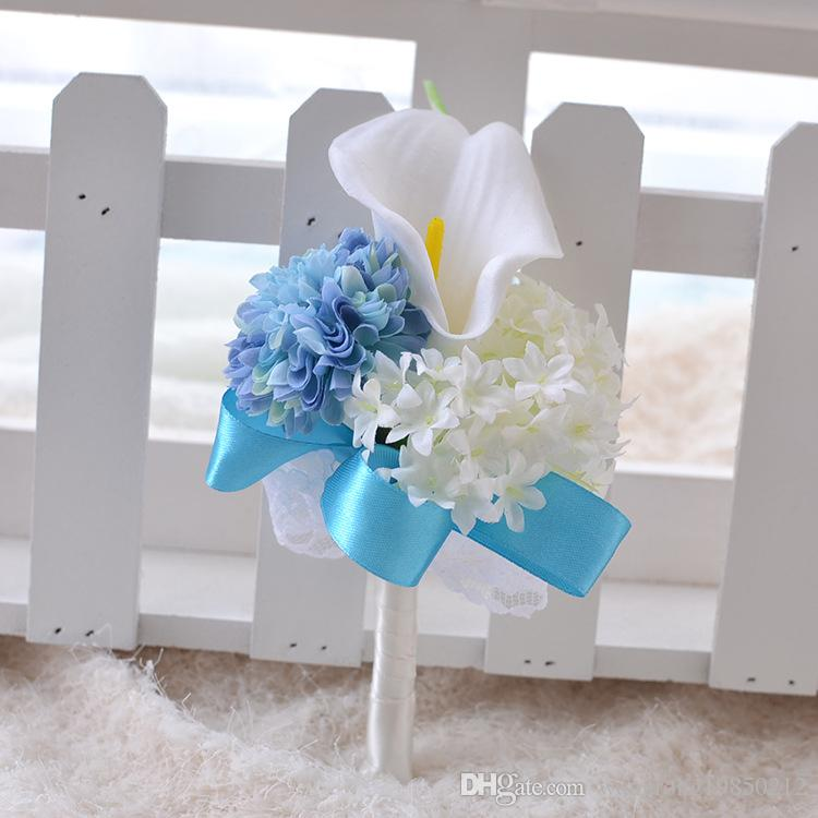 The bride bridegroom Calla lily flower corsage brooches the bride holding flowers bridesmaids bouquet wrist flowers