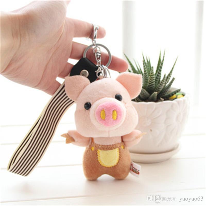Porco dos desenhos animados rabo de porco pigtail mão chaves pequeno pingente chave do carro saco titular pequenos enfeites casal chaveiro