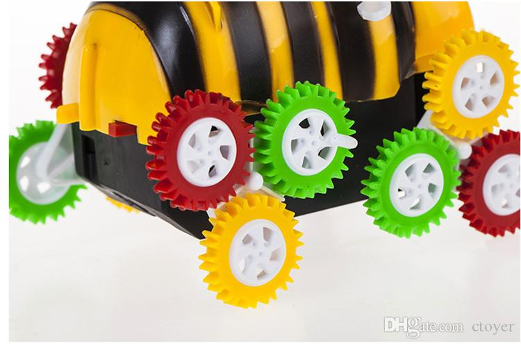 2017 Box Toys Cartoon Encounter Obstacles Flip 12 wheels Funny Bee Dumpers Kids Children Electric Toy Car funny toy