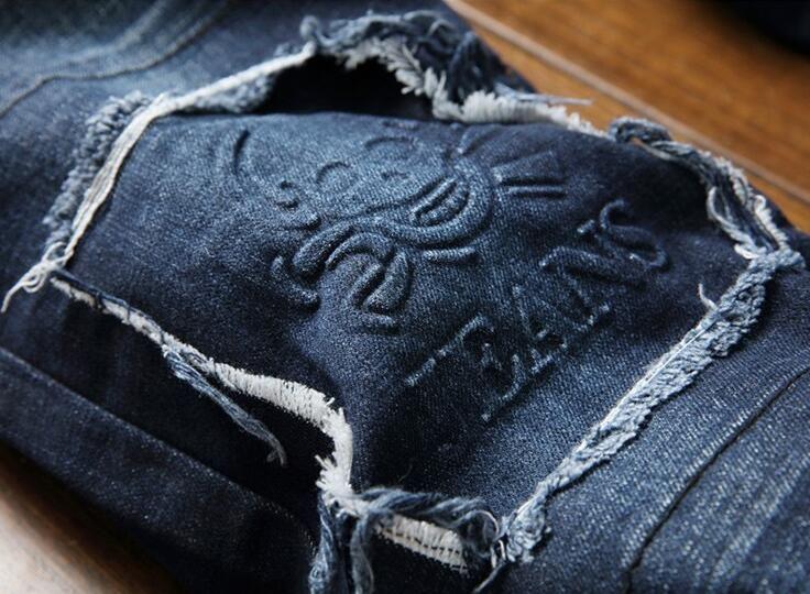 Los vaqueros causales de los hombres vaqueros lavados a la marca diseñan los vaqueros azules oscuros para los hombres artículos de marca