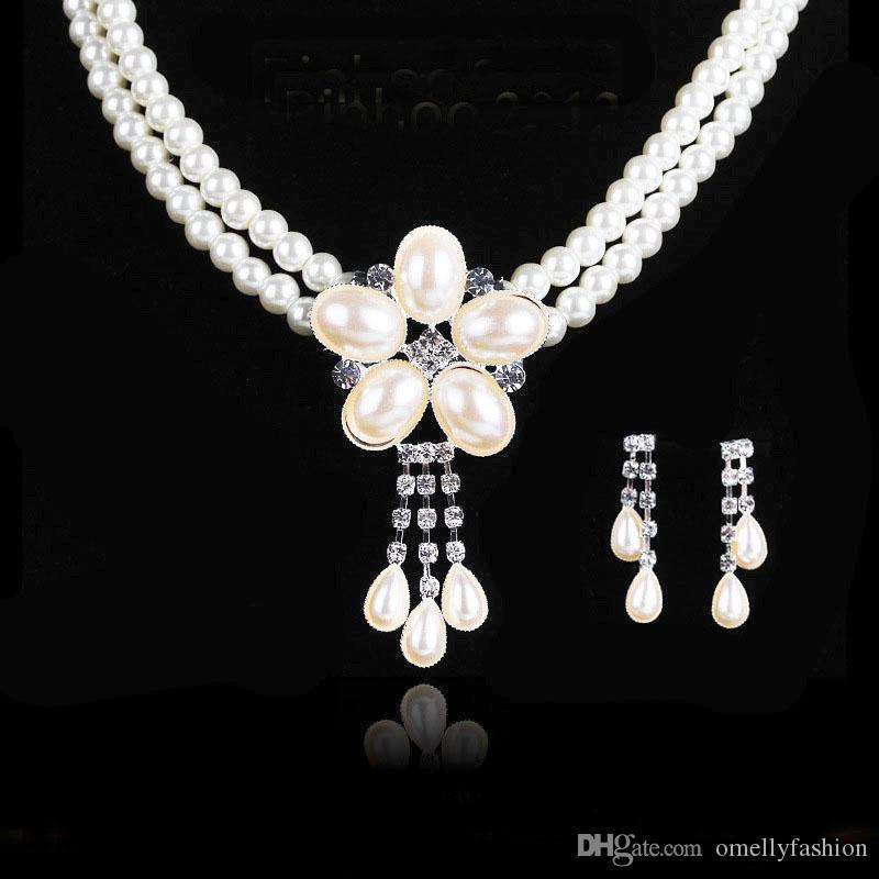 21a13843c4f9 Conjunto de joyas de boda de alta calidad de plata llena de collar de  perlas de imitación y Danlge Oval perla pendientes conjuntos de joyería  elegante ...
