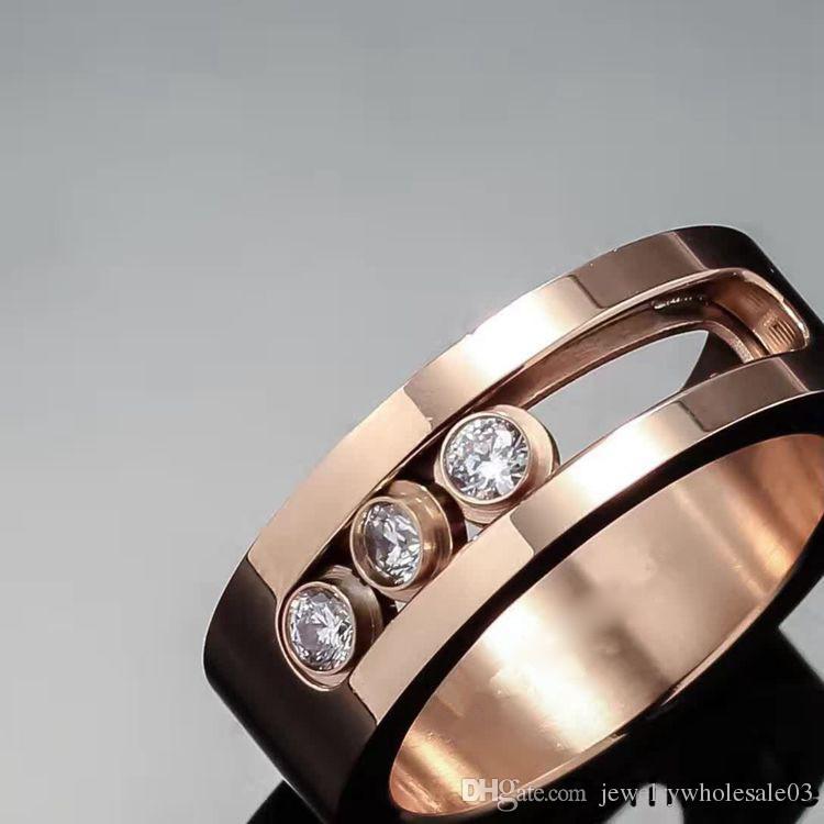 Direct selling fashion European and American jewelry three diamond sliding ring lovers three diamond ring and men's diamond ring