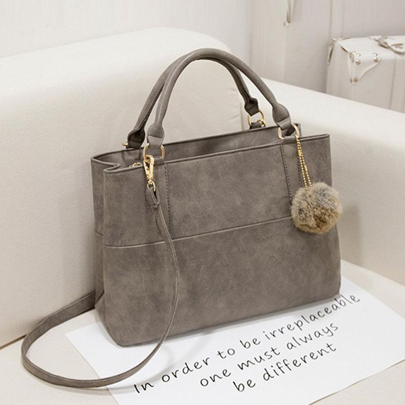 Wholesale Fashion Designer Handbags High Quality Bolsas Shoulder Bag  Messenger Large Tote Bag With A Fur Ball Ladies Hand Bags Purse P712 Mens  Leather Bags ... 925d899ab3