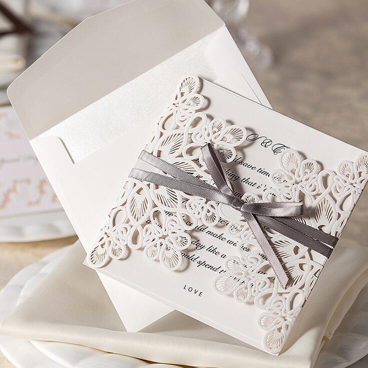 carte d'invito di alta qualità dell'invito di nozze taglio laser personalizzabile di carta del nastro dell'arco del pizzo di cristallo cavo personalizzabile trasporto libero WT01