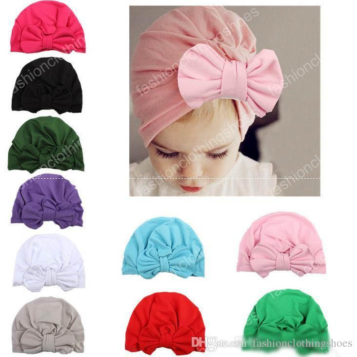 a38f8ccb13a Baby Bow Beanie Hat Cotton Spring Autumn Girls Boys Indian Cap Bohemia  Style Kids Hats Newborn Photography Props Caps Accessories UK 2019 From ...