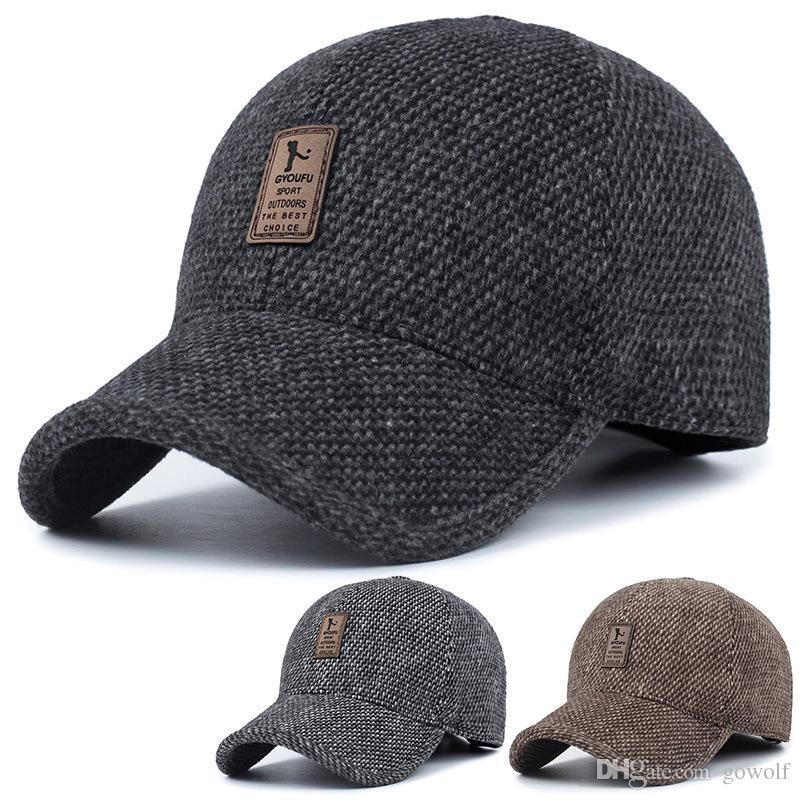 c16ee18e2ac77 2019 Woolen Knitted Design Winter Baseball Cap Men Thicken Warm Hats With  Earflaps Women Men Dad Hat Cap From Gowolf