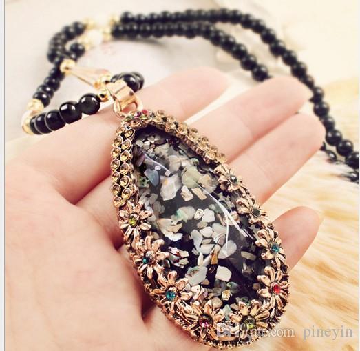 Frauen Dreieck Shell schwarz Perlen Anhänger Halsketten Boho Cat Waterdrop Lange Pullover Kette Halskette NE222