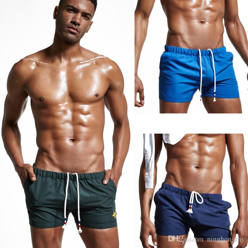 4dd968bb4b1d85 Großhandel Sexy Marke Mens Beachwear Herren Bademode Home Shorts Sommer  Strand Trunk Board Freizeit Shorts Mode Sexy Badehose Boxer Größe M, L, XL,  ...