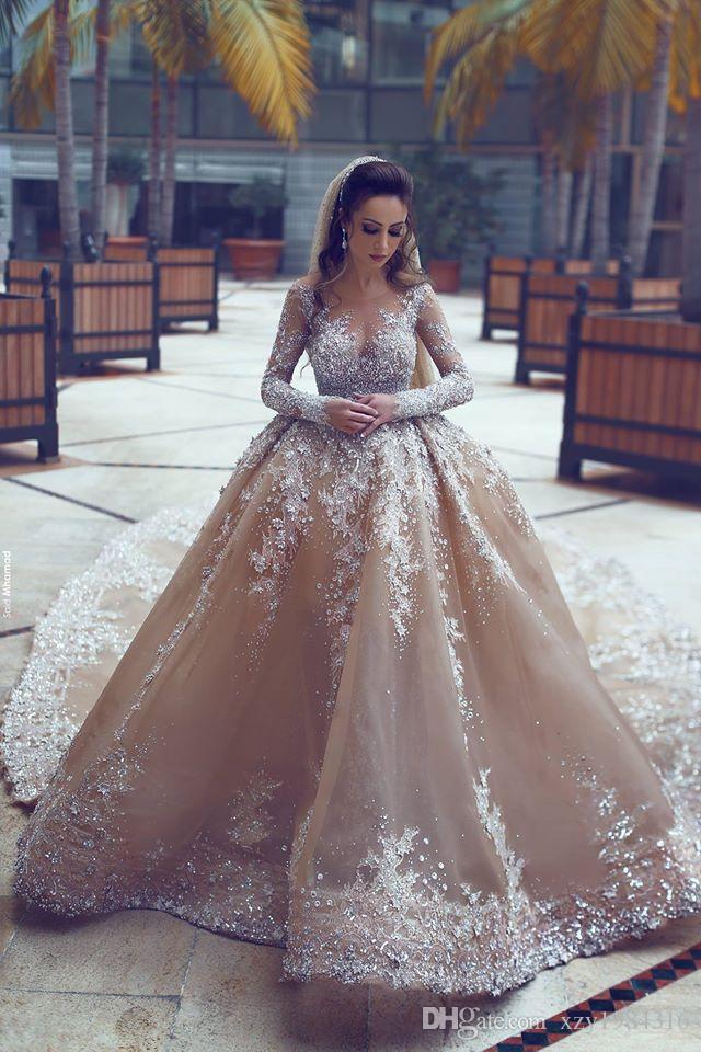 2017 Luxury Rhinestone Dubai Wedding Gowns With Detachable Train Illusion Neckline Long Sleeves Bridal Dress Gorgeous Mermaid Wedding Dress