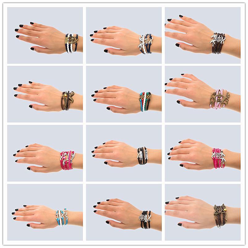 Fabriqué à la main 30 Mélange Style Infinity Cuir Alliage Fashion Bouffon Bracelet Bracelet Bracelet Vintage Accessoires Amoureux Cadeaux