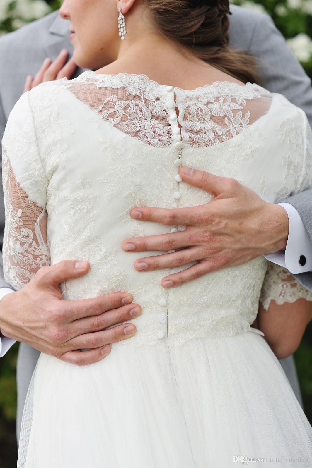 Una línea de encaje de playa de tul Vestidos de boda modestos Mangas cortas Barato Simple Jardín de verano Recepción informal Vestidos de novia Novia madura