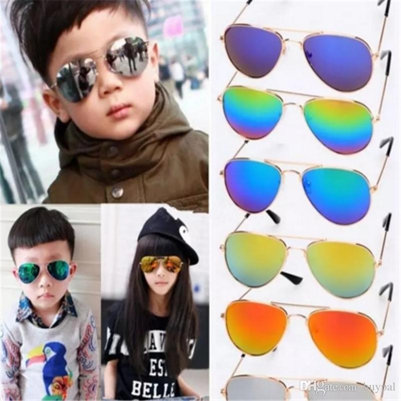 cd1864c81b 2019 Kids Sunglasses Fashion Sun Glasses Children Beach Eyewear UV Protective  Eyeglasses Sunshades Glasses 8 Designs 2017082909 From Buypal