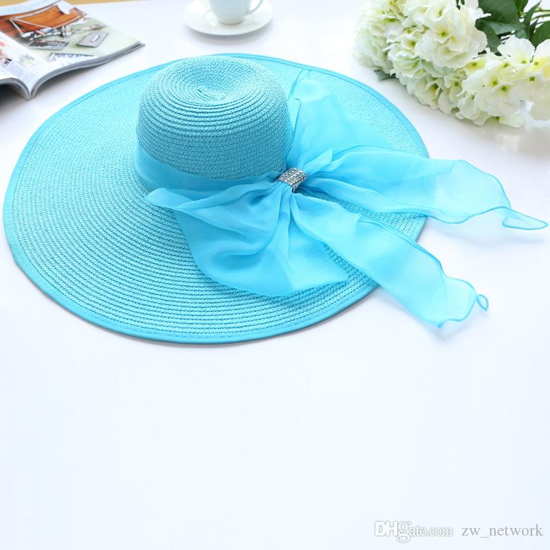 2017 Straw Hats For Women S Summer Ladies Wide Brim Beach Hats Popular  Large Floppy Sun Caps Spring Praia Sunhat Eric Javits From Zw network f31ffaff50c