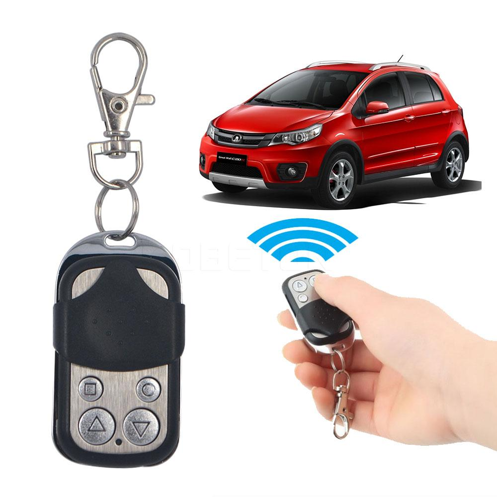 Wholesale- New Wireless Universal Garage Remote Control Duplicate Key Fob 433MHZ Cloning Gate Garage Door Hot Worldwide