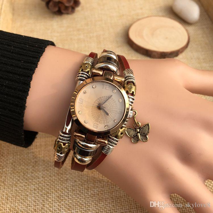 Bracelet en cuir rétro unisexe Tableau dames robe de mode Montre papillon Cartoon étudiants hommes et femmes à la main Quartz bracelet général