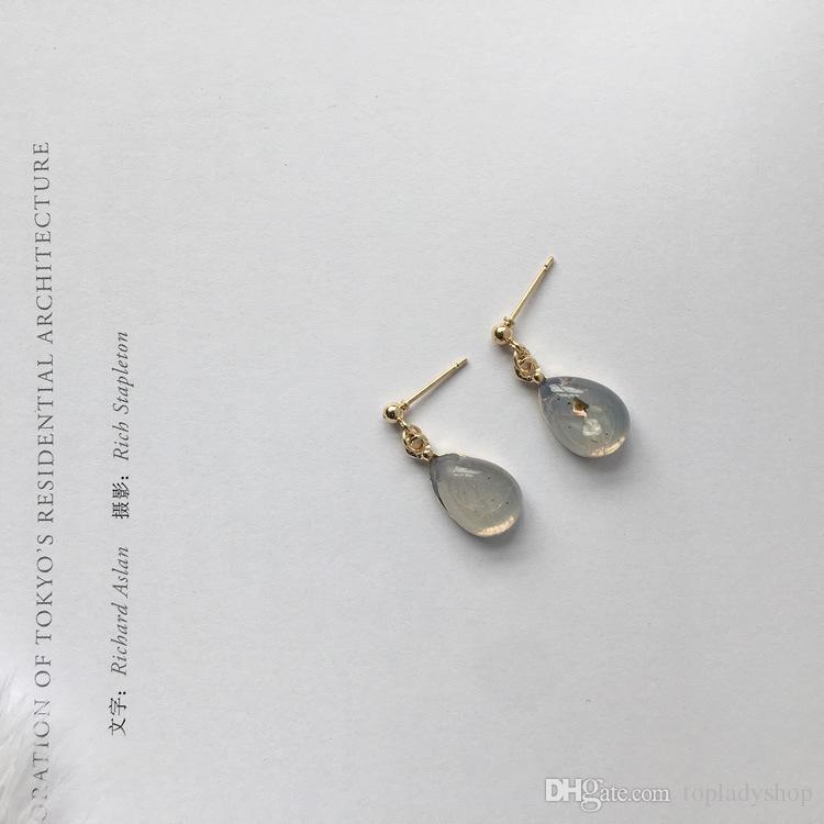 Personalidad simple retro ámbar gotas de agua gema ovalada lentejuelas adornos pendientes venta al por mayor envío gratis