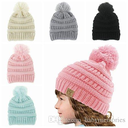 2019 2017 Kids Winter Hat Baby Hats Caps Boys Wool Knitted Hats Girl Beanie  Hat Pom Poms Hats Children Handmade Crochet Baby Bonnets Top Boutique From  ... 664c2f538bb