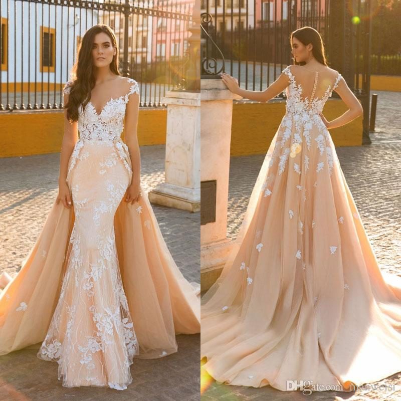 Mermaid blush wedding dresses with detachable train 2017 crystal mermaid blush wedding dresses with detachable train 2017 crystal desing sheer jewel neckline lace appliqued trumpet bridal gowns halter neck wedding dresses junglespirit Choice Image