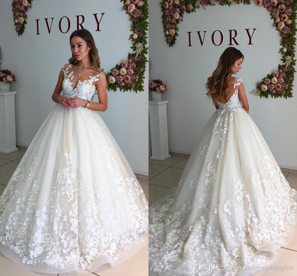 Elegant Ivory Sheer Neck Cap Sleeves Wedding Dresses 2017 New Lace Appliqued Bridal Gowns Ball Gown Long Sweep Train Garden Beach Gowns