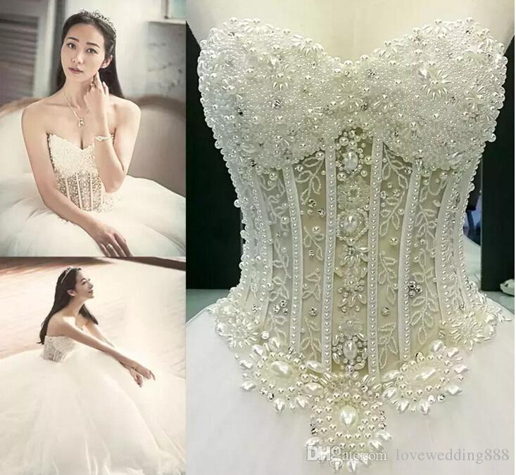 2017 Shiny Luxury Beads Pearls Wedding Dresses Ball Gowns Chapel Tulle Sweetheart Sleeveless Sheer Corset Bodice Queen Bridal Gowns
