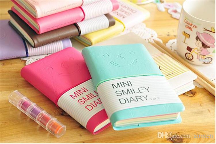 Lindo y colorido mini cuaderno de cuero de sonrisa 7.5 * .12.5 CM 192 hojas de alambre encuadernado 90 g / pc diario de moda para negocios y estudiantes