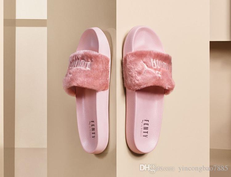 light pink puma slides
