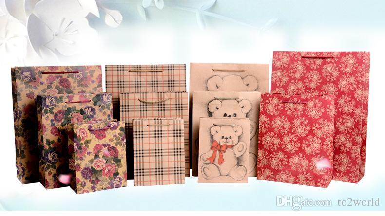 Bolsas de papel de papel artesanal para bolsas de papel de regalo bolsa de compras para la protección del medio ambiente bolsa de dulces de boda al por mayor