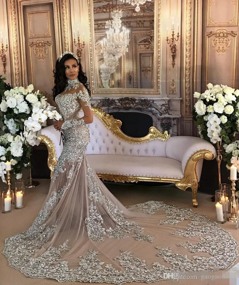 Luxury Sparkly 2019 Wedding Dress Sexy Sheer Bling Beaded Lace Applique High Neck Illusion Long Sleeve Champagne Mermaid Chapel Bridal Gowns