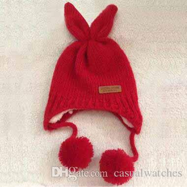 8bd8fdd35b4 Hot Sale Children S Winter Fleece Thicken Knitted Hats Ear Cover Cute  Rabbit Fur Ball Skull Caps Children S Beanie Beanie Hat Sun Hats From  Casualwatches