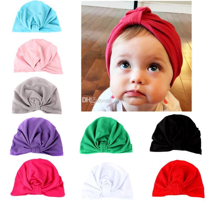 93a4ed662b3 2019 INS Baby Boys Girls Cotton Caps Hats Children Newborn Infants Toddler  Kids Cotton Stretch Cute Hat Beanie Cap Knot Turban Headwear From Melee