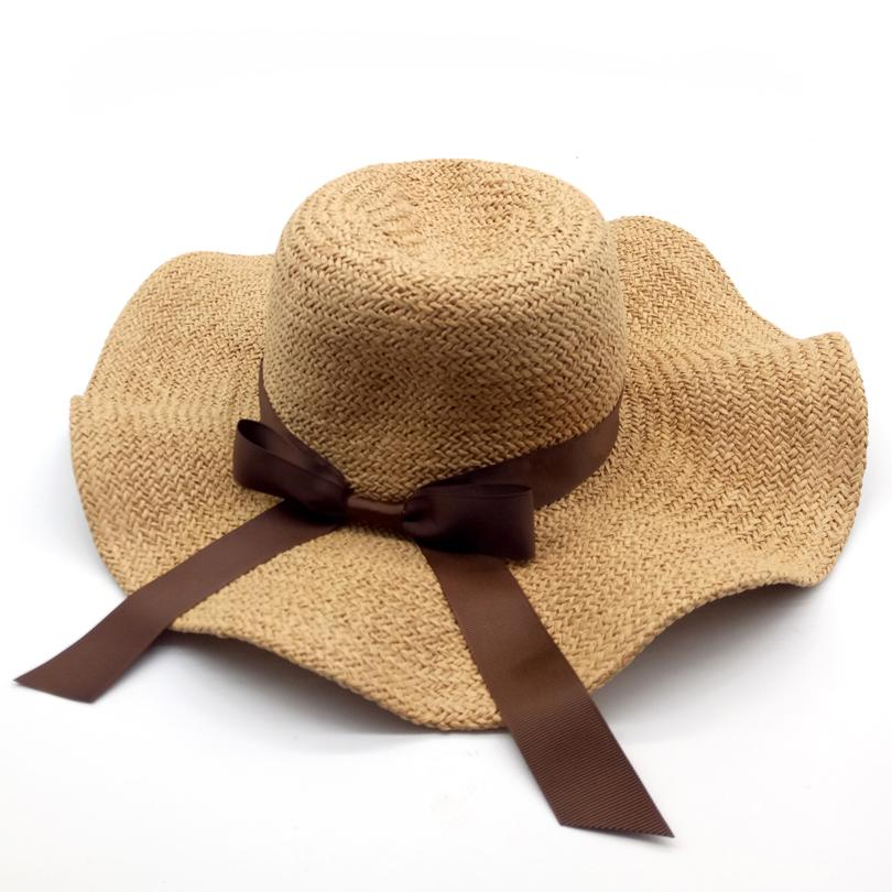 Wholesale Elegant Fashion Sun Hats For Women Bowknot Wide Large Brim Wave  Edge Straw Hat Summer Beach Hat Girl Travel Casual Hats ZLH 045 Winter Hats  For ... fb94a4b85c88