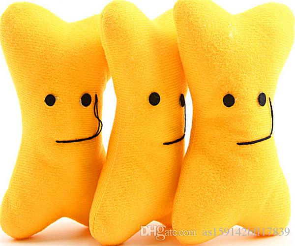 2017 nuevos juguetes de peluche de hueso, juguetes para perros, mordedura de peluche, expresión facial, cara sonriente, juguetes de tipo hueso, tamaño amarillo, 14 CM * 9 CM